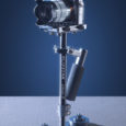 Glidecam.com Features: Dynamic Camera Balance Platform (Camera Mounting Platform) Adjustable convergence, precision, three-axis Gimbal No-tools Telescoping Center Post Adjustable, inertial-control Base Platform Foam padded Handle Grip Precision Bearings at all...